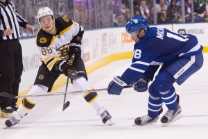 Boston Bruins' David Pastrnak, left, battles for the puck with Toronto Maple Leafs' Milan Michalek during third period NHL hockey action, in Toronto on Saturday, October 15, 2016. THE CANADIAN PRESS/Chris Young