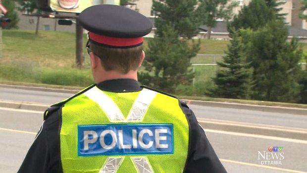 An Ottawa police officer stands on the side of the road in this file photo.
