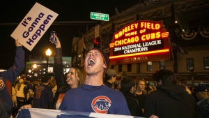 Chicago Cubs fans celebrate outside Wrigley Field after the Cubs defeated the Los Angeles Dodgers 5-0 in Game 6 of baseball's National League Championship Series in Chicago on Oct. 22, 2016. (Ashlee Rezin / Chicago Sun-Times)