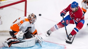 Philadelphia Flyers goalie Steve Mason makes a save off Montreal Canadiens' Max Pacioretty (67) in Montreal on Oct. 24, 2016. (Paul Chiasson / THE CANADIAN PRESS)