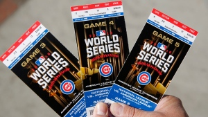 Chicago Cubs baseball fan Robert Lyons shows his World Series tickets outside Wrigley Field on Oct. 24, 2016. (Michael Tercha / Chicago Tribune via AP)