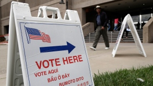 Signs direct voters outside of the Santa Clara County Registrar of Voters in San Jose, Calif., on Oct. 24, 2016. (Marcio Jose Sanchez / AP)