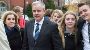 Dennis Oland and his wife Lisa, along with family members and friends, head from a bail hearing after being released from custody in Fredericton on Tuesday, Oct. 25, 2016.  (Andrew Vaughan / THE CANADIAN PRESS)