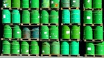 File - Oil barrels stacked on a loading dock.