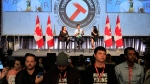 Protesters turn their backs on Prime Minister Justin Trudeau as he addresses the Canadian Labour Congress National Young Workers' Summit in Ottawa on Tuesday October 25, 2016. THE CANADIAN PRESS/Fred Chartrand