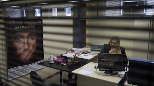 Debora Rodrigues, chief investigator of the crimes against woman unit, works in her office in Sao Goncalo, Brazil, Tuesday, Oct. 25, 2016. (AP Photo / Leo Correa)