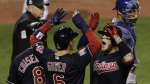 Cleveland Indians' Roberto Perez celebrates with Brandon Guyer and Lonnie Chisenhall after hitting a three-run home run during the eighth inning of Game 1 of the Major League Baseball World Series against the Chicago Cubs in Cleveland on Tuesday, Oct. 25, 2016. (AP / Gene J. Puskar)