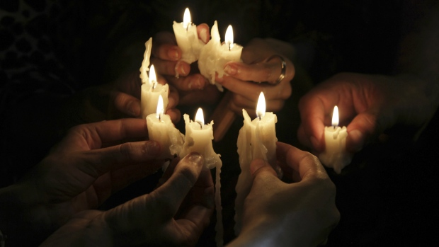People light candles to pay tribute to the victims of an overnight attack on the Quetta Police Training Academy during a vigil in Lahore, Pakistan, Tuesday, Oct. 25, 2016. (AP / K.M. Chaudary)