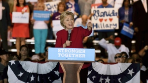 Democratic presidential nominee Hillary Clinton speaks at an early voting rally on the Broward College campus in Coconut Creek, Fla. on Tuesday, Oct. 25, 2016. (Maria Lorenzino /South Florida Sun-Sentinel via AP)
