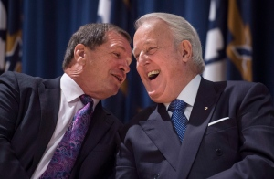Former Prime Minister Brian Mulroney, right, and fellow St. Francis Xavier University alumni Frank McKenna, former New Brunswick premier and Canadian diplomat, share a laugh before the announcement of the $60 million Brian Mulroney Institute of Government and Mulroney Hall at St. Francis Xavier University in Antigonish, N.S. on Oct. 26, 2016. (Darren Calabrese / THE CANADIAN PRESS)