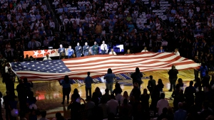 First responders hold a flag on the court as the national anthem is played during a tribute to the victims of the Pulse nightclub shooting prior to an NBA basketball game between the Orlando Magic and the Miami Heat, Wednesday, Oct. 26, 2016, in Orlando, Fla. (AP Photo / John Raoux)
