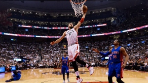 Toronto Raptors centre Jonas Valanciunas (17) dunks the ball past Detroit Pistons forward Tobias Harris (34) during first half NBA basketball action in Toronto on Wednesday, October 26, 2016. (THE CANADIAN PRESS / Nathan Denette)