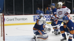 New York Islanders goalie Thomas Greiss looks over his shoulder at the puck after Montreal Canadiens defenceman Shea Weber scored the team's third goal during the third period of an NHL hockey game in New York on Wednesday, Oct. 26, 2016. (AP / Mary Altaffer)