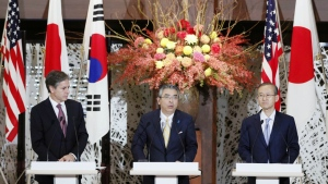 U.S. Deputy Secretary of State Antony Blinken, left, Japanese and South Korean counterparts Shinsuke Sugiyama, centre, and Lim Sung-Nam, attend a joint press conference in the Iikura guesthouse in Tokyo on Thursday, Oct. 27, 2016. (Kyodo News)