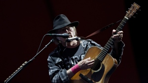 Canadian singer and composer Neil Young performing at the Roskilde Festival in Roskilde, Denmark, Friday evening, July 1, 2016. (Thomas Borberg/AP)