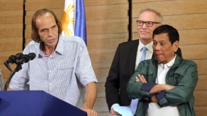 In this Sept. 18, 2016, file photo, released Norwegian hostage Kjartan Sekkingstad, left, briefly delivers his statement after meeting Philippine President Rodrigo Duterte, right, in Davao city in southern Philippines. (Manman Dejeto/AP)