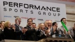 Performance Sports Group CEO Kevin Davis, center, is joined by company executives as he rings the New York Stock Exchange opening bell, to mark the company's first day of trading, Friday, June 20, 2014. (Richard Drew/AP)