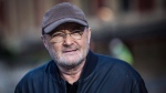 Singer Phil Collins poses for photographers during a photo call to promote his upcoming tour and book 'Not Dead Yet' in London, Monday, Oct. 17, 2016.  (Vianney Le CaerAP)