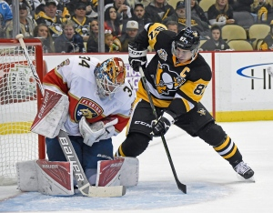 Florida Panthers goalie James Reimer (34) makes a save as Pittsburgh Penguins center Sidney Crosby (87) waits for a rebound during the second period of an NHL hockey game on Tuesday, Oct. 25, 2016, in Pittsburgh. (Fred Vuich / THE CANADIAN PRESS)