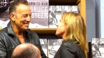 Bruce Springsteen chats with a fan at a Toronto Indigo store on Thursday, October 27, 2016.