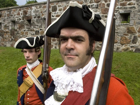 Stefan Tremblay, front, and Danny Deshenes wear period British army uniforms at Fort Ste. Helen Tuesday, June 12, 2008 in Montreal, Quebec. (Ryan Remiorz / THE CANADIAN PRESS)