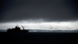 Chile's Navy ship Aquiles moves alongside the Hurd Peninsula, seen from Livingston Islands, in Antarctica on Jan. 25, 2015. (AP / Natacha Pisarenko)