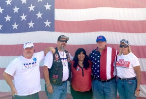 Attendees at a motorcycle rally in Pompano Beach, Fla., on Sunday, Oct. 23, 2016, including Gabe Carrera, second from left, who in a speech expressed annoyance at Republican leaders for not sufficiently supporting Trump. (THE CANADIAN PRESS/Alexander Panetta)