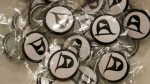 Pirate party pin badges ready for distribution to the public during an advertising event for the upcoming Iceland Parliamentary Elections at a shopping mall in Reykjavik, Wednesday, Oct. 26, 2016. (Frank Augstein/AP)