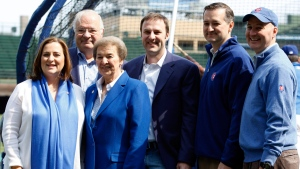 From left are Chicago Cubs board members Laura Rickets, Joe Ricketts, Marlene Ricketts, owner and board member Todd Ricketts, board Chairman Tom Ricketts and board member Pete Rickets. (Nam Y. Huh / AP)