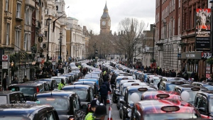 London taxis protesting competition from services such as Uber block the roads in central London, on Feb. 10, 2016. (Frank Augstein / AP)