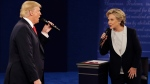 Republican presidential nominee Donald Trump and Democratic presidential nominee Hillary Clinton speak during the second presidential debate at Washington University in St. Louis. (John Locher / The Associated Press)