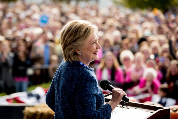 Democratic presidential candidate Hillary Clinton pauses while speaking at a campaign rally at NewBo City Market in Cedar Rapids, Iowa, Friday, Oct. 28, 2016. (AP / Andrew Harnik)