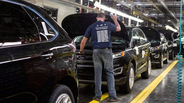 New Ford Edges sit on a production line as Ford Motor Company celebrates the global production start of the 2015 Ford Edge at the Ford Assembly Plant in Oakville, Ont., on Thursday, February 26, 2015.THE CANADIAN PRESS/Chris Young