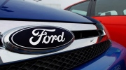 The Ford logo is seen on cars for sale at a Ford dealership in 2012. As talks continue between Ford Canada and its unionized workers on Oct. 31, 2016, a strike deadline is looming. (AP / Seth Perlman)
