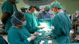 In this file photo, doctors perform an open heart surgery in San Salvador on Thursday, July 3, 2008. (AP / Luis Romero)