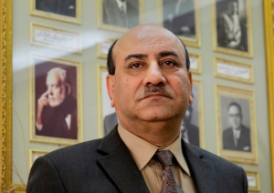 In this April 16, 2014 file photo, Hesham Genena, then head of Egypt's oversight body, poses for a portrait in front of pictures of his predecessors at his office in Cairo, Egypt. (AP / Amr Nabil)