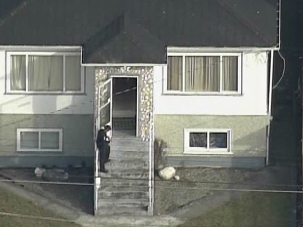 At least one person was shot inside this Fraser Street residence in East Vancouver on Tuesday, Feb. 17, 2009. (CTV Chopper 9)