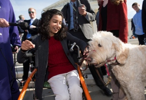 Ehlena Fry, 12, of Michigan, sits with her service dog Wonder, while speaking to reporters outside the Supreme Court in Washington, Monday, Oct. 31, 2016, following oral arguments on a case where Fry, who has cerebral palsy, wants to sue school officials for refusing to let her bring a service dog to class. (AP / Molly Riley)