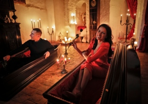 Events manager Tami Varma and her brother Robin, a PhD student, the grandchildren of Devendra Varma, a scholar of English gothic tales and an expert in vampire lore, pose in coffins at Bran Castle, in Bran, Romania, Monday, Oct. 31, 2016. A Canadian brother and sister are passing Halloween night curled up in red velvet coffins in the Transylvanian castle that inspired the Dracula legend, the first time in 70 years anyone has spent the night in the gothic fortress after they bested 88,000 people who entered a competition hosted by Airbnb to get the chance to dine and sleep at the castle in Romania. (AP Photo/Vadim Ghirda)