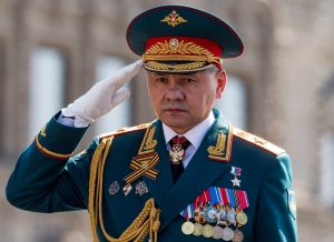 In this Saturday, May 7, 2016 file photo, Russian Defense Minister Sergei Shoigu salutes to his soldiers as he is driven along Red Square during a rehearsal for the Victory Day military parade. (AP Photo/Alexander Zemlianichenko, file)