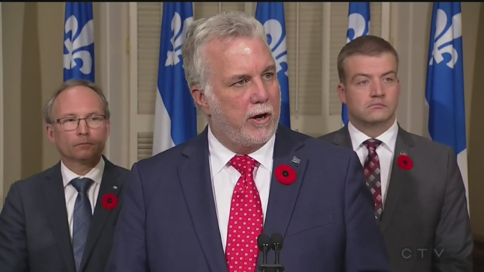 Premier Philippe Couillard denounces the steps police took in investigating a journalist