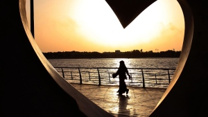 Saudi woman seen through a heart-shaped statue on the Red Sea in Jiddah, Saudi Arabia, on May 11, 2014. (Hasan Jamali / AP)