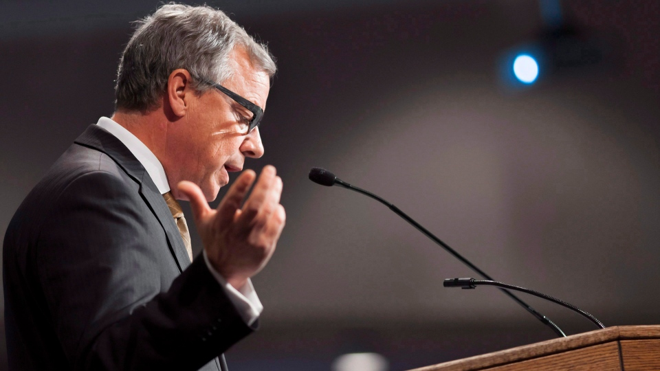 Saskatchewan Premier Brad Wall gestures during a speech on climate change to the Regina Chamber of Commerce at the Conexus Arts Centre in Regina on Tuesday Oct. 18, 2016. Wall spoke about his concerns about the Trudeau government's national carbon tax plan. THE CANADIAN PRESS/Michael Bell