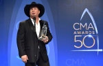 Garth Brooks, winner of the award for entertainer of the year, participates in an interview in the press room at the 50th annual CMA Awards at the Bridgestone Arena on Wednesday, Nov. 2, 2016, in Nashville, Tenn. (Photo by Evan Agostini/Invision/AP)