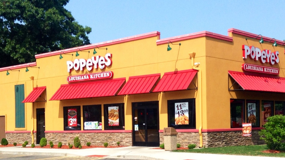 The parent company of Tim Hortons and Burger King says it will pay $1.8 billion cash to buy the Popeyes Louisiana Kitchen chain in a friendly deal.