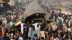 Pakistani volunteer rescuers work at the site of a train accident in Karachi, Pakistan, on Nov. 3, 2016. (Shakil Adil / AP)