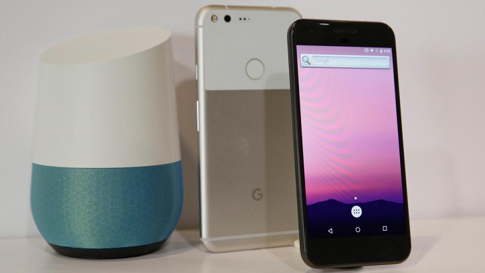 Google Pixel phones displayed next to a Google Home smart speaker. (Eric Risberg / AP)
