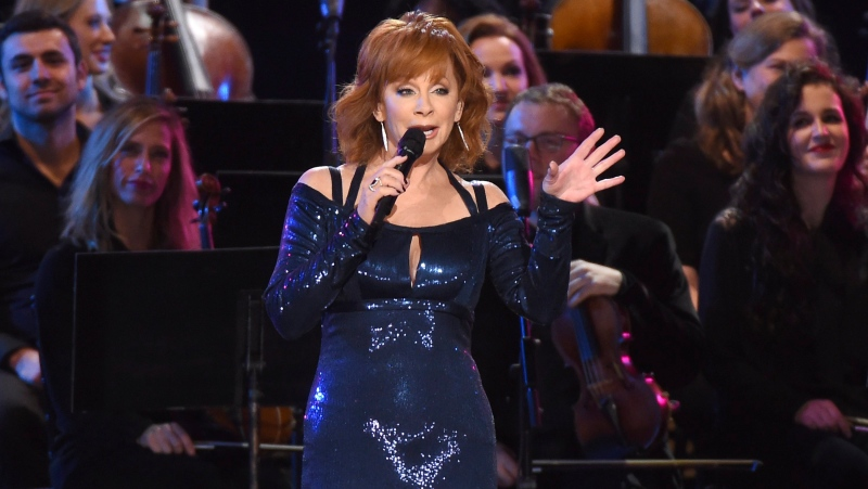 Reba McEntire performs during a tribute to Dolly Parton at the 50th annual CMA Awards at the Bridgestone Arena on Wednesday, Nov. 2, 2016, in Nashville, Tenn. (Photo by Charles Sykes/Invision/AP)