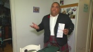Bagpiper Jeff McCarthy holds the ticket he received for carrying a weapon