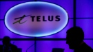 A Telus sign is pictured at company's annual meeting in Vancouver on May 8, 2014. (Darryl Dyck/The Canadian Press)